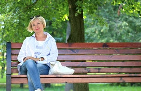 Woman by bench
