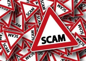 Word scam in warning triangle